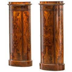 A pair of elegant oval-shaped Biedermeier cupboards | From a unique collection of antique and modern corner cupboards at https://www.1stdibs.com/furniture/storage-case-pieces/corner-cupboards/