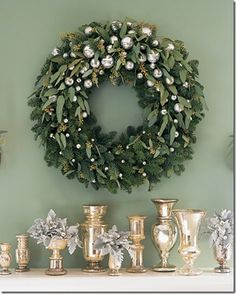 Mercury ball Ornaments & Vases:: Classy.  Evergreens• laurel leaves• white berries & small mercury ball ornaments; all make a simple, but elegant Christmas wreath.