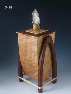 Steven Smith: Handmade with beautiful exotic woods, rounded legs and a handle made of agate