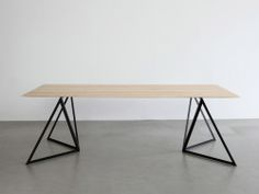 Steel Stand Table is a minimalist design created by Germany-based designer Sebastian Scherer. The base is composed of a triangular metal structure made of powder coated steel. I picked this example because the legs are facing in different directions, similar to Greece's iconic bidirectional animal legs.