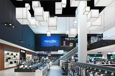 A project by Ippolito Fleitz Group Identity Architects. Exhibition Stand Design, Exhibition Booth, Techno, Ceiling Installation, Corporate, Store Fixtures, Communication Design, Brand Store, Booth Design
