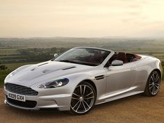 """#32. As with all """"real"""" Aston Martin coupe models, the 510hp V12-powered DBS was also available as a Volante convertible during its run (2009 – 2012); witness this home-market example in the then-recent """"Lightning Silver"""" color."""