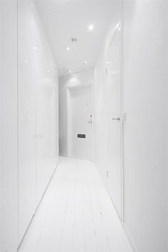 Wonderful Clean White Small Apartment Interior Design with Minimalism in Mind : Clean White Small Apartment Interior Design With White Wall Wooden Door Wardrobe Hardwood Floor And Lamp Design Small Apartment Interior, Apartment Design, Interior Design With White Walls, Bali, Cleaning Closet, Cool Apartments, Lamp Design, Wooden Doors, Contemporary Style