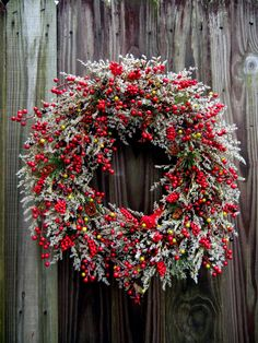 This beautiful Christmas Wreath will take you through the holidays and winter. Ive used natural german statice to enhance the multitude of berries. This wreath measures 20 Keep in a protected area  To see my entire collection of wreaths and arrangements you may visit my shop at