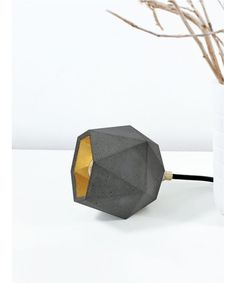 [T2]up_dark FLOOR LIGHT TRIANGLE – GOLD, SILVER OR COPPER designed by GANTlights made in Germany as part of Lighting and Floor Lamps and Table Lights tagged Concrete Home Accessories and Geometric Lighting Collection - image 1 on CROWDYHOSUE