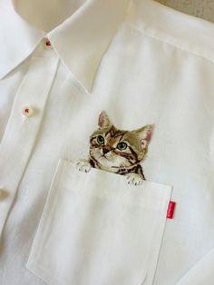 Cat pocket. Artist Hiroko Kubota Embroiders