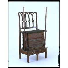 Exercise chairs like this mahogany example were sometimes called 'chamber-horses', because the users bounced up and down, exercising their legs in a way similar to riding a horse. They were an early equivalent of the modern indoor exercise bicycle. They were advertised from as early as 1740, and were evidently still used in 1803