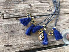 Μια ιδιαίτερη σειρά χειροποίητων μαρτυρικών με σχέδια που ξεχωρίζουν και ονομασίες ελληνικών νησιών.  Μαρτυρικό βάπτισης κολιέ από τη σειρά ΠΑΤΜΟΣ από μπλε κορδόνι με 2 σειρές,  1 μπλε ρουά φούντα, 1 μικρή στρογγυλή χρυσή χάντρα και μεγάλο σταυρό χρυσού χρώματος διακοσμημένο στο κέντρο με μπλε ρουά ματάκι. Διατίθεται σε συσκευασία των 50 τεμ. Christening, Tassel Necklace, Jewelry, Jewlery, Jewerly, Schmuck, Jewels, Jewelery, Fine Jewelry