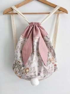 I have this fabric! This bunny backpack is cute.