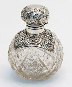 Cut glass and silver perfume bottle, Birmingham. Circa 1906. Offered by Goldsmith & Perris at Alfies Antique Market.