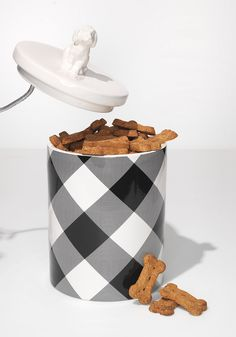 In trendy buffalo plaid, this treat canister, created by fashion designer Adam Lippes in a collaboration with Target, adds a modern touch to any milk bone.