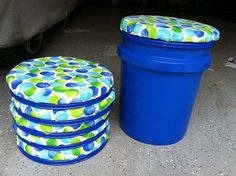 Bucket stools! 10-gallon buckets from the hardware store with foam and fabric stapled to the top. A fun seat for little wiggly kids and extra storage in the classroom!—claireg496f001caLearn how to make the seats just using E6000 glue on Room4Imagination, and how to make them with a staple gun on Leaving My Mark.