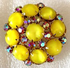 "This vintage gold tone pin is a  cluster of prong set aurora borealis rhinestones with prong set bright yellow glass stones.  It measures   2 1/4""...  #aurora borealis #cabochon #gold #pink #yellow #vintage #jewelry"