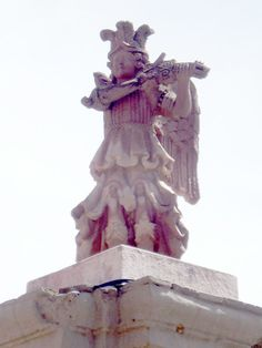 An Angel on top of a building.