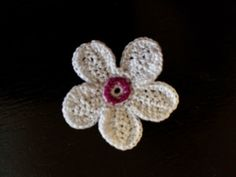 This post is moved from my original blog. I'm designing an Irish Crochet piece (finally!!!)with cherry blossoms all over it, and I couldn't find just the right flower motif to make it l…