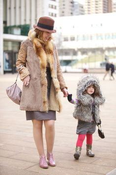 NYFW Girl Style. Fur, bright tights and metallic footwear. Photo by Ryan Koopmans - http://www.youandeyeblog.blogspot.nl/2011/02/fashion-week-outsiders.html. #Fashion #Kids #Fur