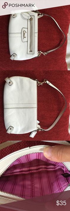 White Coach wristlet White coach wristlet with pink/fuchsia interior. Perfect condition. No pen marks or stains. Coach Bags Clutches & Wristlets