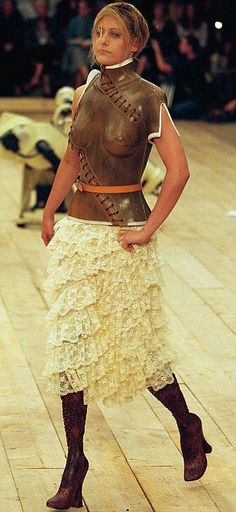 Controversial: McQueen sent double amputee model Aimee Mullins down the catwalk on carved wooden legs    Read more: http://www.dailymail.co.uk/femail/article-1250371/Alexander-McQueen-A-life-fashion.html#ixzz1s32abY56