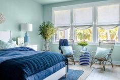 Sun-drenched coral tones infuse this spacious master bedroom with warm colors that feel bright and fresh. Hgtv, Home Living Room, Bedroom Essentials, Home, Serene Bedroom, Rustic White, White Panel Beds, Comfortable Seating Area, Guest Bedroom