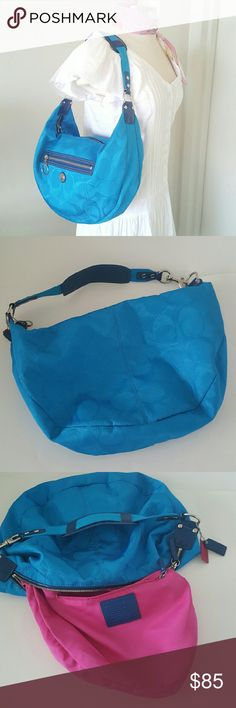"""Coach Blue Canvas Hobo Bag  Daisy B1093-F14873 Authentic bag from Coach, electric  blue canvas with trim leather patent,  fuchsia fabric lining,  zip top closure,  zippered pockets exterior,  zippered pockets interior,  two additional pockets for cell phone or accessories. One strap purse, silver tone hardware. Like new never been worn,  dimensions are 17"""" x 11"""" x 3"""" Coach Bags Hobos"""
