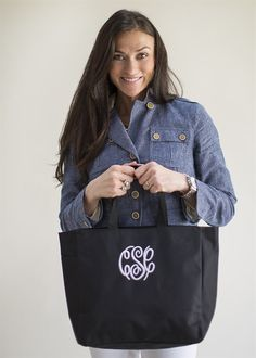 "Our popular monogrammed Preppy Tote is a great all-around bag!  This tote has an inside pocket as well as a large side pocket for so many uses!  It's the perfect size for everyday use - not too big and not too small.   Personalized gifts are always special and this tote bag is the perfect gift for any occasion! 600 denier polyesterLarge main section with small interior self-fabric pocketsLeft side exterior pocketWeb handlesBag Dimensions: 12""h x 1..."
