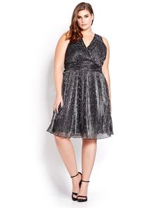 Get your glam on in this sexy fit and flare dress with deep V neckline and glittering metallic chiffon. Plus size, crossover neckline. Back keyhole button closure. Fully lined. 42 inch length.