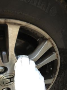 I rinse the rim with water to get it wet and take a dry un-used dryer sheet to start wiping away.