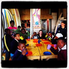 Lunch after a surf for the children from Christian David's primary school with our volunteers from @ivhq and DTR. Hannelie one of our customers couldn't resist grabbing a chair and joining the conversation about their surf. SURFING is Sharing is Caring. - @surfshack_capetown- #webstagram