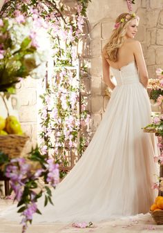 Romantic Wedding Dress with Alencon Lace on Soft Net Designed by Madeline Gardner. Colors available: White and Ivory, Champagne
