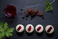 Macaron with Pelargonium flavored white chocolate ganache, and a quince carré in the middle.