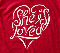 """She is Loved - Red, Cotton T-shirt - $20, from the Veil of Tears Store. 100 percent of the money received from this T-shirt will go toward Gospel for Asia's """"Hope for Suffering Women"""" fund."""