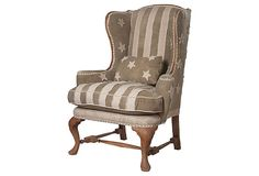 Andrew Jackson Wing Back Chair combines stone-washed, stars-and-stripes muslin and nailhead trim with mahogany wood stained to a natural aged satin finish