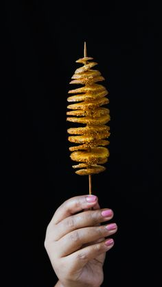 Spiral out of control with the crispiest potatoes you'll ever have on a stick. The best part is all the fun condiments you can pour over it.