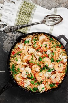 Seafood Paella Recipe from The Mediterranean Dish.  I think I would add chicken or pork or both! Yummy.