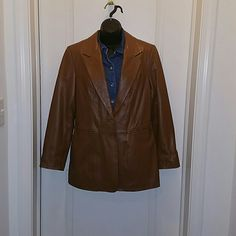 """Tan 100% leather blazer jacket ❤ Tan100% genuine leather blazer!     one button closure and two front side pockets. Button at the end of each sleeve and back bottom has small slit. The jacket lining is a solid tan and is 100% Polyester. Measures 24"""" long with a sleeve length of 18"""" long from the armpit down.  purchase with the light blue leather blazer jacket for only $30! denim & co Jackets & Coats Blazers"""