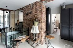 expose brick wall, glass, metal, very tall door.....perfect loft space