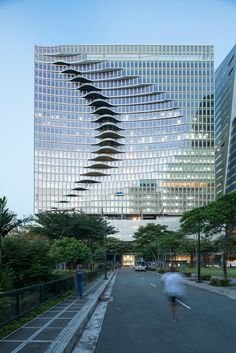 Newly Opened City Center Tower in Manila Has a Glass Wave Facade Futuristic Architecture, Facade Architecture, Beautiful Architecture, Contemporary Architecture, Landscape Architecture, Ancient Architecture, Sustainable Architecture, Unique Buildings, Interesting Buildings