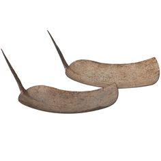 rare African currency in the shape of a spade or hoe