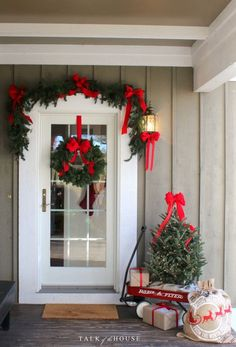 door Christmas decorating tree in wagon