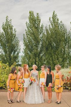 Picking a common color palette can make your bridesmaids look uniform, but still express their individuality. It's also a good way to set your maid of honor apart.