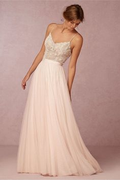 Chic Sophisticated Wedding Dresses for Romantics: The stunning and the meticulously hand-beaded Ella bodysuit featuring iridescent opals and glass beads, under the Amora Skirt with layers of airy, ivory tulle. http://www.confettidaydreams.com/chic-sophisticated-wedding-dresses/