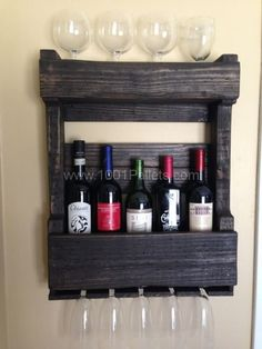 Pallets wall wine rack   1001 Pallets  Various wine racks that can hang on the wall.