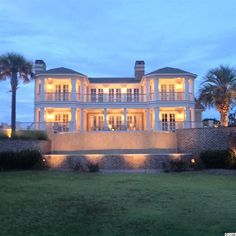 9002 N Ocean Blvd. Myrtle Beach, SC 29572 - This 5992 heated square foot masterpiece boasts a grand double staircase entry and gorgeous views of the ocean and marsh. - Being offered at $2,199,000.  #myrtlebeachrealestate #myrtlebeachhomesforsale
