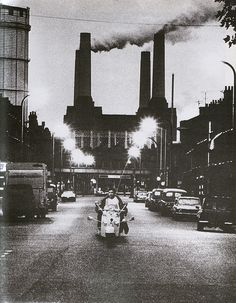 Mod riding his scooter on Queenstown Road, with the Battersea power station on the background. Photograph by Ethan A. From sleeve notes of Quadrophenia Vintage London, Old London, South London, Battersea Power Station, Art Deco Stil, London History, Willis Tower, London England, Vintage Photos