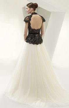 Black sequins open back jacket over Ivory tulle dress. Something special can be found at Mia Boutique