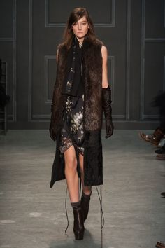 "Vera Wang Gives Us the Chicest Goth Possible: Vera Wang is about the last designer we would imagine sending out a slogan tee, but there it was on her Fall 2014 runway: the chicest black-and-gray tee with ""You Bug Me"" on the front and a cicada on the back."