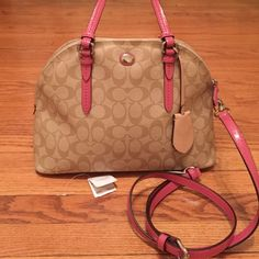 Coach handbag satchel Coach handbag, color khaki pink. Comes with original tag and strap. Can be worn as a satchel and as a cross body bag. Perfect condition, only worn once. I love this bag and will be sad to see it go. Please let me know if you have any questions. Coach Bags Satchels