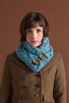 A cozy cabled cowl knit with 5 balls of 5 balls of Big Liberty Wool and size 10 needles.
