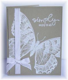 SU butterfly—embossed in white on kraft.