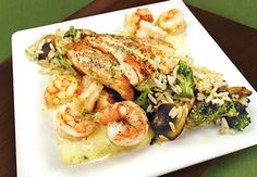 Seafood recipe: Pan Seared Shrimp and Salmon with a vegetable rice pilaf.